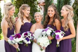 bridesmaids-in-dark-purple-dresses-hold-bouquets