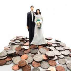 plastic-bride-and-groom-on-a-pile-of-coins-ft